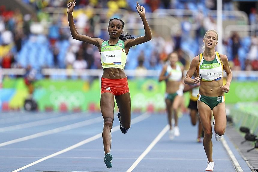 Ethiopian Almaz Ayana crossing the finish line to set a new world record in the 10,000m, with silver medallist Vivian Cheruiyot nowhere in sight.