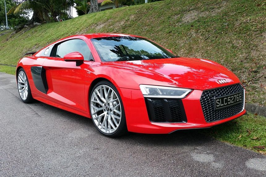 The Audi R8 (above) has a suite of steering- mounted controls (left), which makes it easy to access various functions.