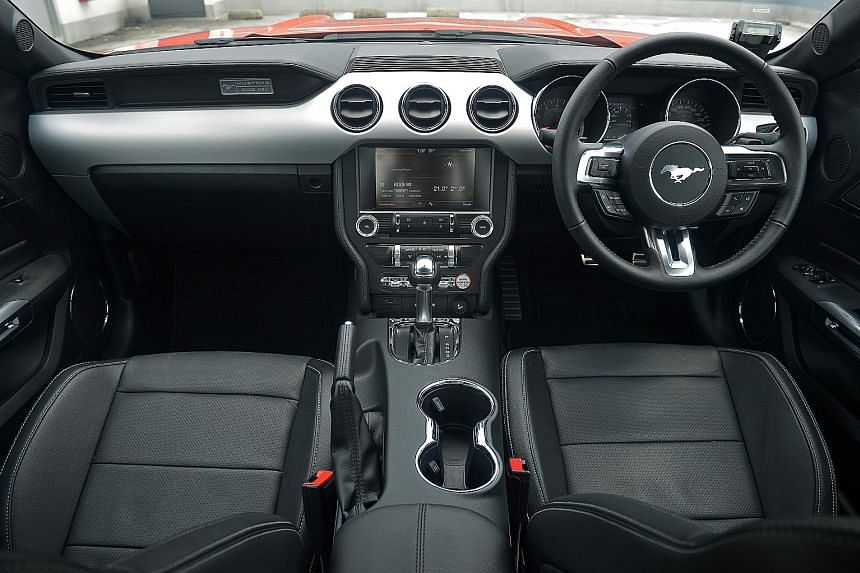 The cockpit (left) of the sixth-generation Mustang (far left).