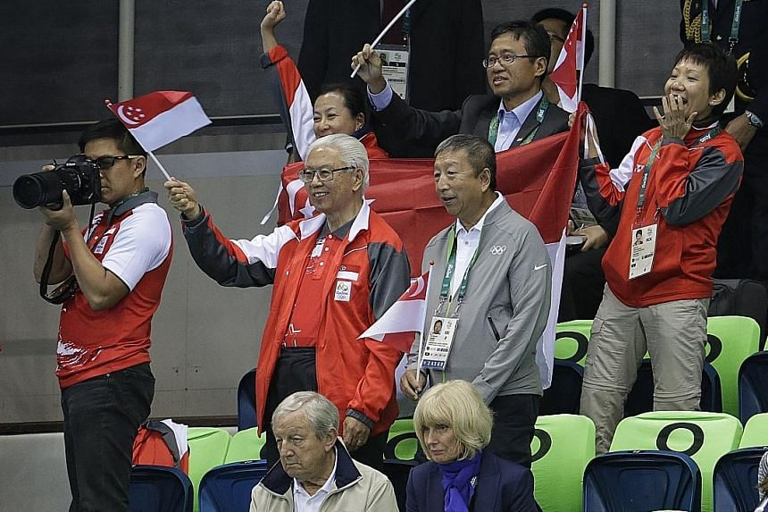 President Tony Tan and International Olympic Committee executive board member Ng Ser Miang supporting swimmers Joseph Schooling and Quah Zheng Wen at the Olympic Aquatics Stadium on Thursday. Dr Tan is on a five-day visit to Brazil.