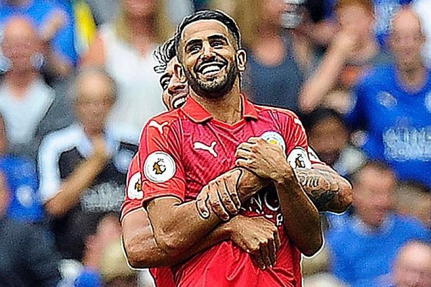 An uplifting experience for Leicester City's Riyad Mahrez at the hands of striker Leonardo Ulloa during the 6-5 win on penalties against Celtic on July 23. Manager Claudio Ranieri has insisted Mahrez will be staying, joking that he would kill the Alg