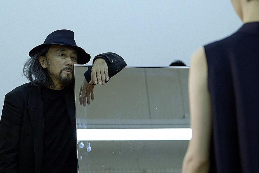 Fashion designer Yohji Yamamoto (above) in a scene from the documentary, Yohji Yamamoto   Dressmaker.