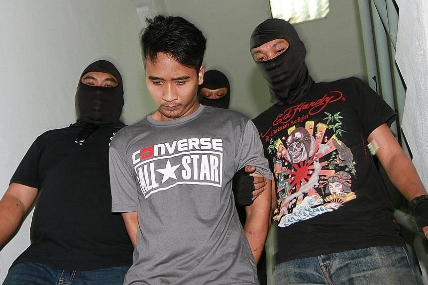 One of the six who are accused of supporting ISIS. No pleas were recorded but all six accused nodded to indicate that they understood the charges against them.