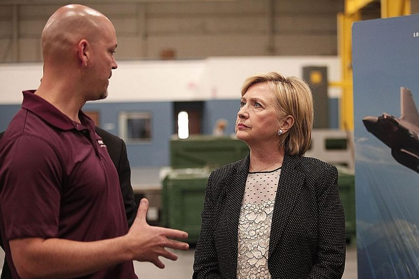 Mrs Clinton tours Futuramic Tool and Engineering before giving her speech in Warren, Michigan.