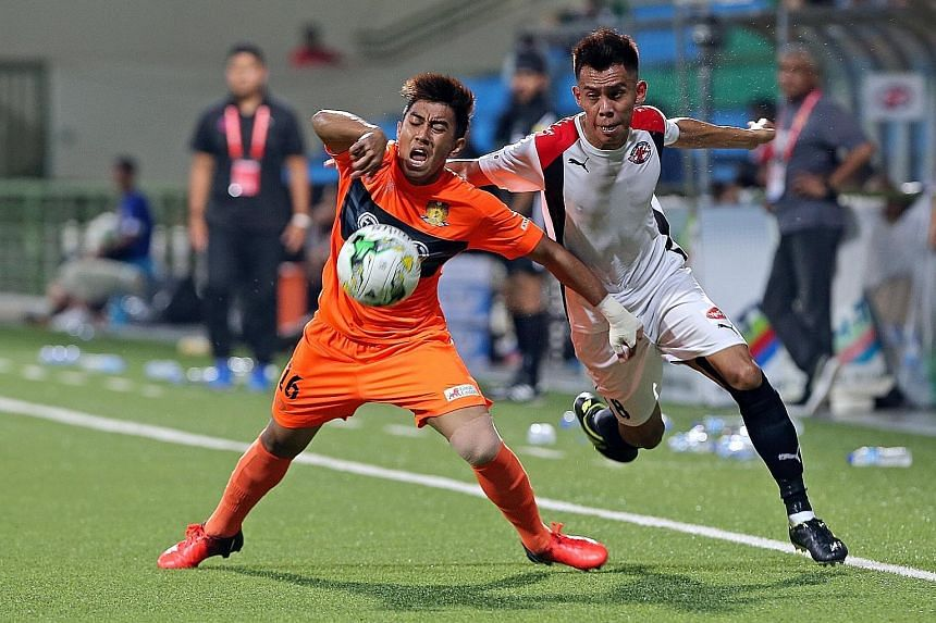 Hougang midfielder Raihan Rahman (left) held back by (right) Home United's Azhar Sairudin. Hougang United won 4-2, recovering from an early two-goal deficit to move to within one point of third-placed Brunei.
