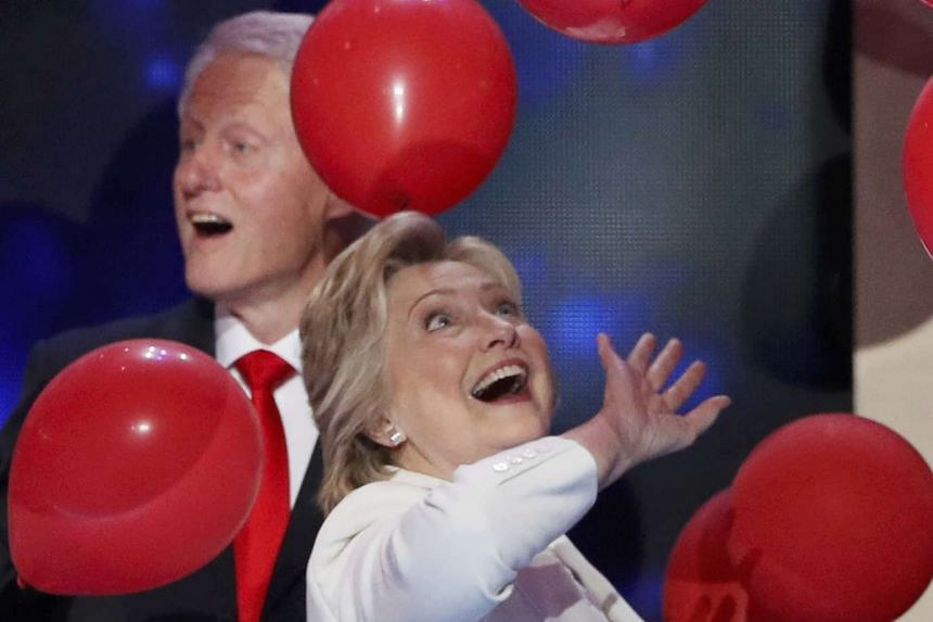 Hillary Clinton bats balloons with husband Bill after accepting the Democratic nomination on July 28, 2016.