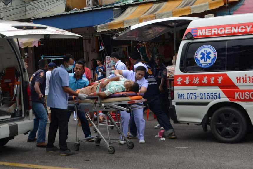 Injured people receive first aid after a bomb exploded on Aug 11 in Trang, Thailand.