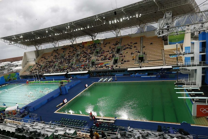 The water in the diving competition pool is green before the start of the men's synchronised 3m springboard final on Aug 10, 2016.