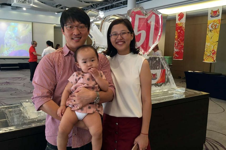 Singaporean Grace Wong, her Korean husband Jimmy Kim and one-year-old daughter Alice at the 51st National Day reception in Seoul.