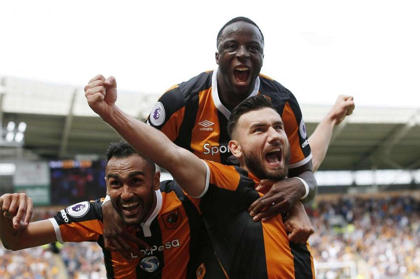 Hull City's Robert Snodgrass celebrating after scoring his side's second goal against Leicester City.