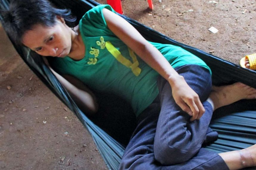 Jungle woman Rochom P'ngieng laying on a hammock at a village in Rattanak Kiri province.