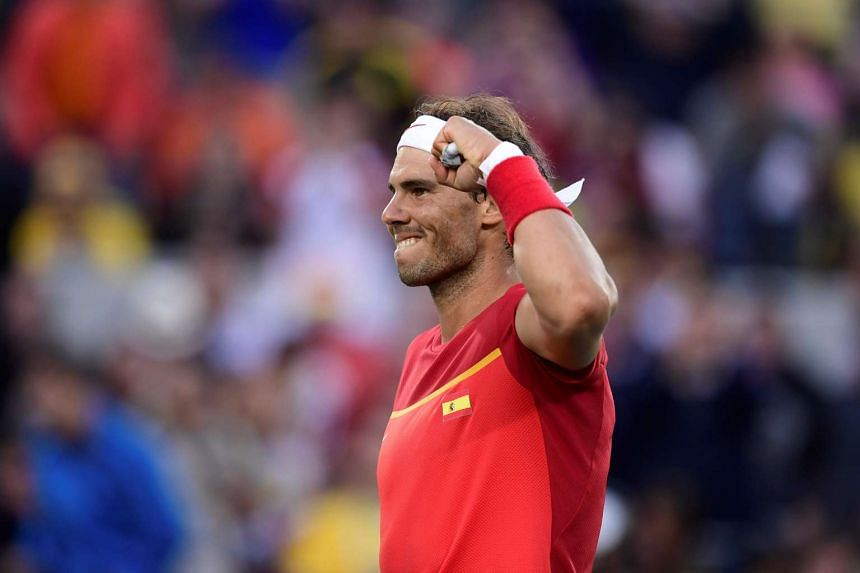 Spain's Rafael Nadal celebrates after winning his men's singles quarter-finals match.