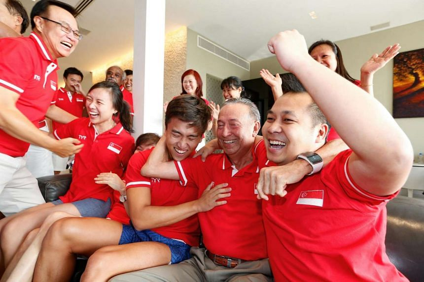 Joseph Schooling's father, Colin Schooling, watches the 100m butterfly final at a friend's home.