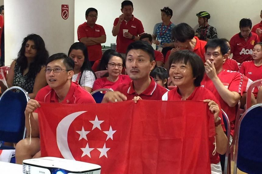MPs Teo Ser Luck (left), Baey Yam Keng and Lee Bee Wah cheering Joseph Schooling on at the OCBC Aquatic Centre.