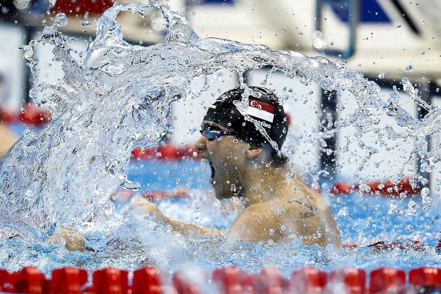 Joseph Schooling celebrates after winning in the men's 100m butterfly final race of the Rio 2016 Olympic Games Swimming events on Aug 12.