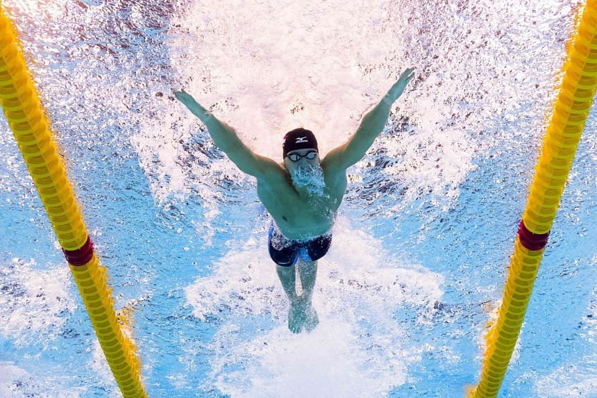 Joseph Schooling takes part in the men's 100m butterfly final during on Aug 12.