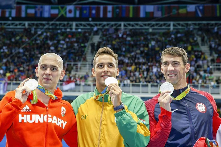 Joint silver medalists Michael Phelps of the USA (right to left), Chad Guy Bertrand Le Clos of South Africa, and Laszlo Cseh of Hungary during the medal ceremony for the men's 100m butterfly final.
