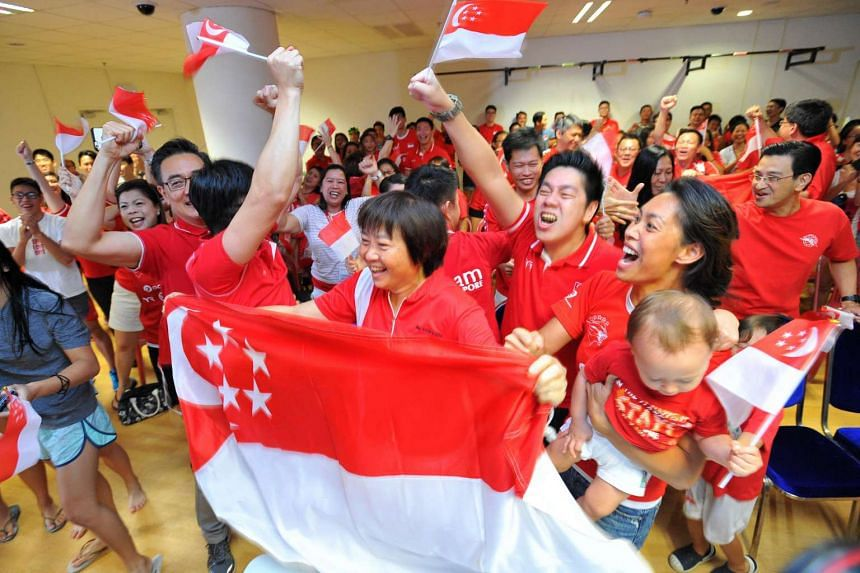 The OCBC Aquatic Centre Gymnasium was packed with supporters during the live screening of the Olympics Men's 100m butterfly finals.
