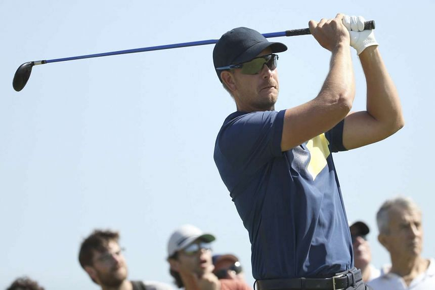 Henrik Stenson hits a tee shot on the ninth hole during the third round of the men's Olympic golf competition, on Aug 13, 2016.