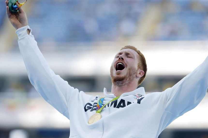 Christoph Harting of Germany celebrating on the podium after winning the men's discus at the Rio 2016 Olympics in Rio de Janeiro on Aug 13, 2016.