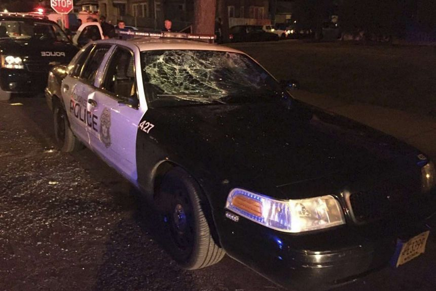 A damaged police car is seen after violence broke out in Milwaukee, Wisconsin, on Aug 13, 2016.
