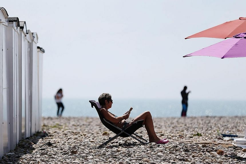 The right reading material can help enhance a holiday on the beach.