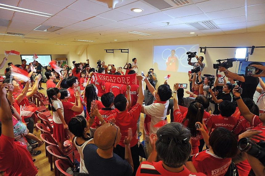 Emotions running high among the crowd at the OCBC Aquatic Centre in Singapore, as Schooling stands on the winner's podium, hand to heart, with the National Anthem being played during the 100m butterfly victory ceremony in Rio. Schooling's winning tim