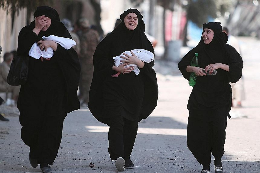 Women carrying newborn babies react with joy after getting evacuated by the Syrian Democratic Forces from Manbij. Losing the Syrian city is a big blow to the ISIS terror group, as it is of strategic importance, serving as a conduit for the transit of