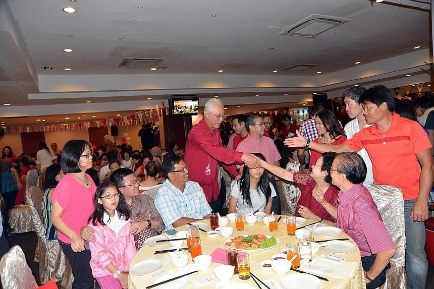 Mr Goh with residents at a National Day dinner in Marine Parade last night. He said leaders had to put the people above their own ambitions and interests, and expressed confidence in new MPs and ministers.