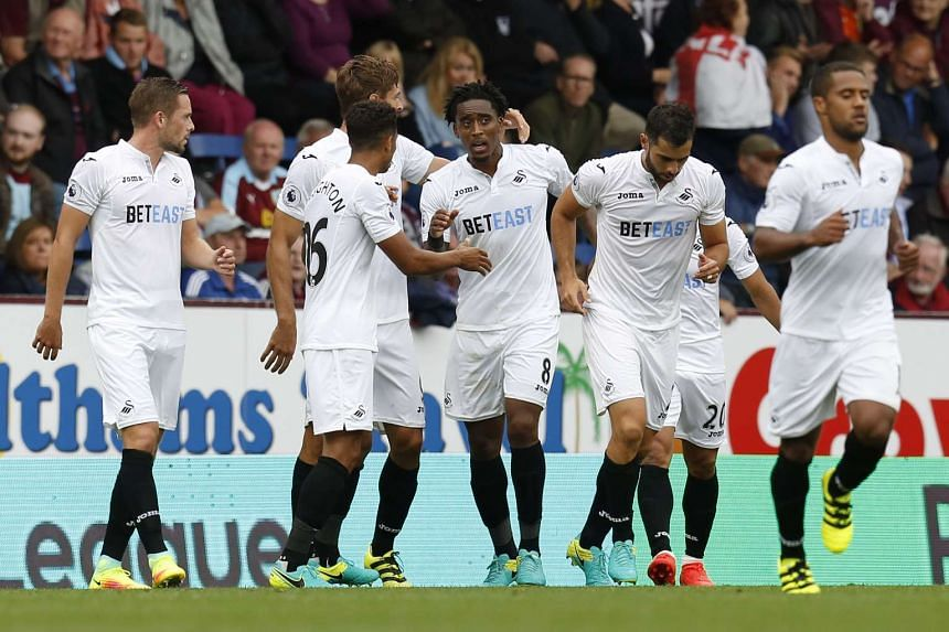 Swansea City's Leroy Fer celebrates scoring their first goal with team mates.