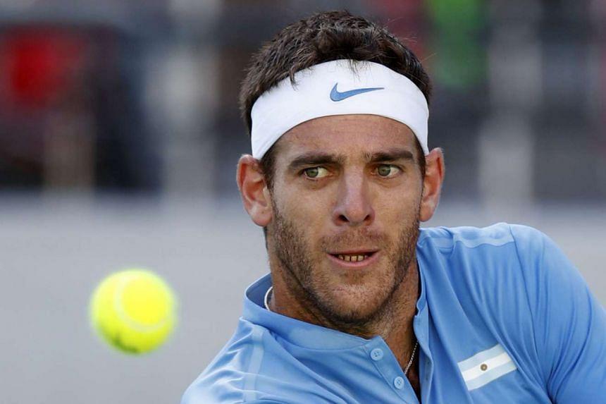 Juan Martin del Potro of Argentina returns a ball to Rafael Nadal.