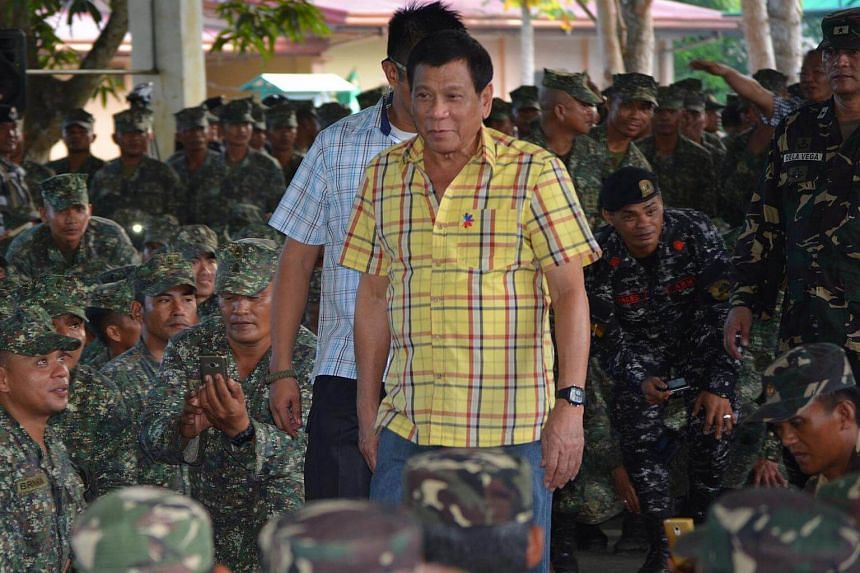 Philippine President Rodrigo Duterte arrives at a military camp in the town of Jolo, Sulu province on August 12.