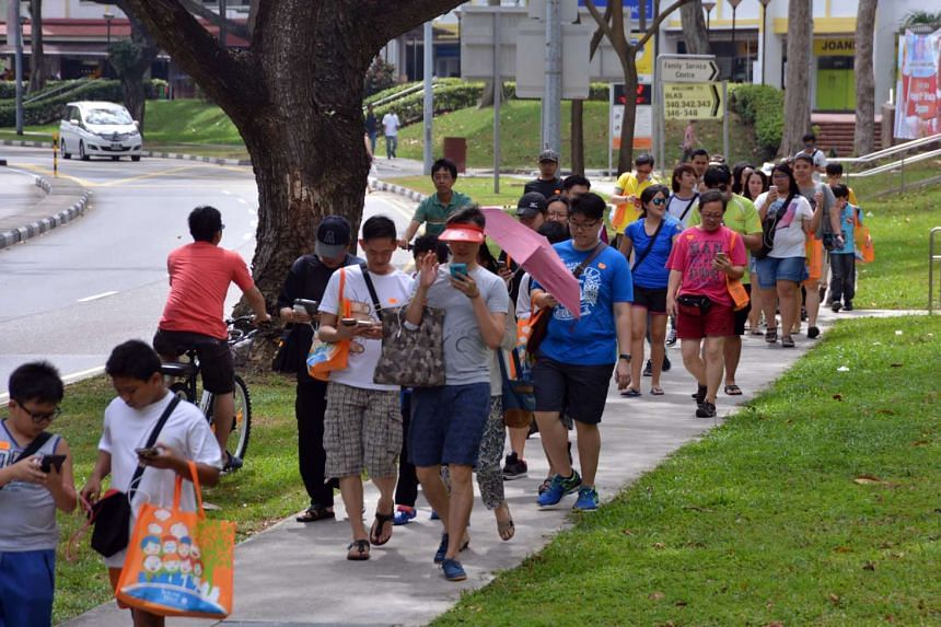 Residents taking part in the Great Clementi Pokemon Go outing along Clementi Avenue 5 on Aug 14, 2016.