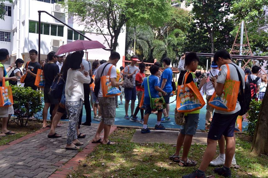 Residents stopping at Clementi Block 357 during the Great Clementi Pokemon Go outing on Aug 14, 2016.