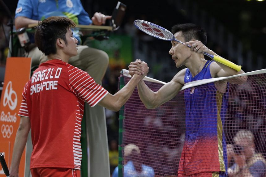 Singapore's Derek Wong (left) congratulates Malaysia's Lee Chong Wei after his loss to the world No. 1 in Rio de Janeiro, on Aug 14, 2016.