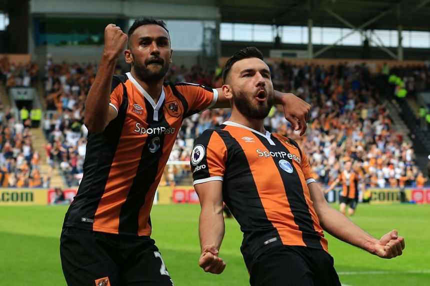 Hull City midfielder Robert Snodgrass (right) celebrates with team-mate Ahmed Elmohamady after scoring their second goal.