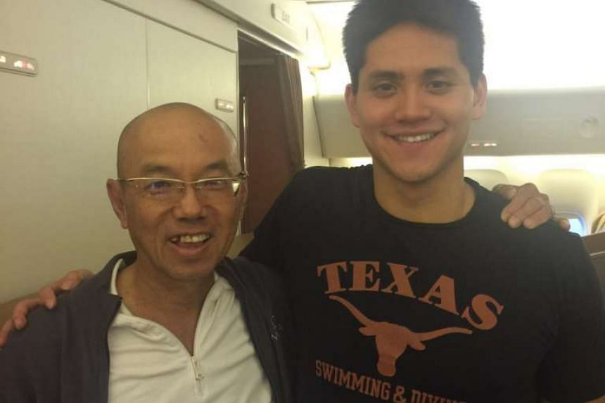 Speaking to Editor-at-large Han Fook Kwang (left) on the flight, Schooling said he is looking forward to eating Chye Tow Kway (carrot cake) in Singapore. The pilot of the flight announced to passengers that Schooling and his mother May are on board a