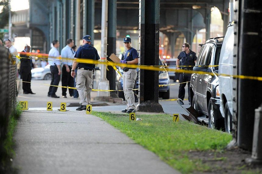 New York City police at the spot where Imam Maulama Akonjee was killed in the Queens borough of New York City, on August 13.