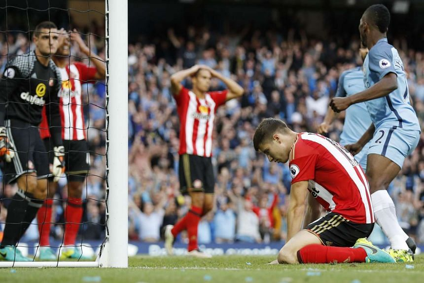 Sunderland's Paddy McNair looks dejected after scoring an own goal.