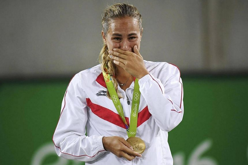 Gold medalist Monica Puig of Puerto Rico reacts after receiving her medal.