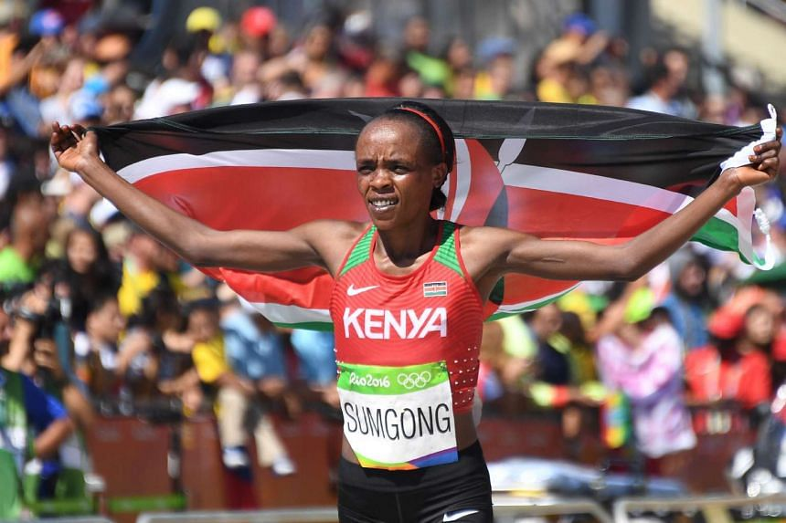 Kenya's Jemima Jelagat Sumgong celebrates her victory in the Women's Marathon at the Rio 2016 Olympic Games on Sunday (Aug 14).