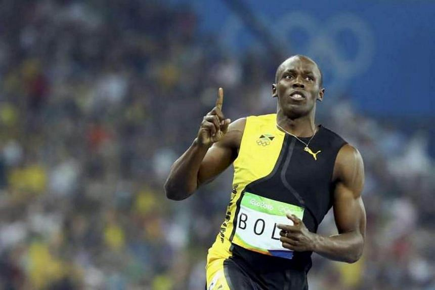 Usain Bolt of Jamaica celebrates winning the men's 100m final with a timing of 9.81s.