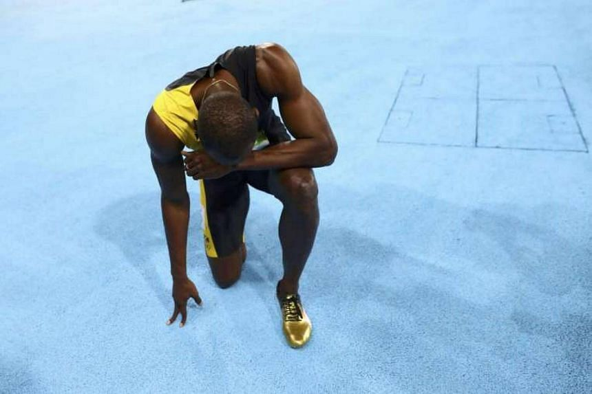 Usain Bolt reacts to winning his third Olympic title in a row.
