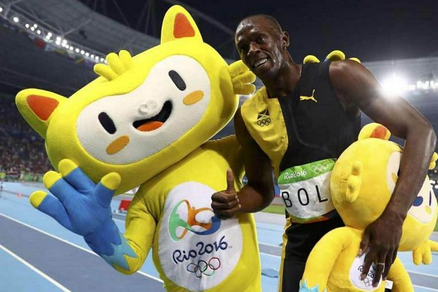 Usain Bolt celebrates his win.