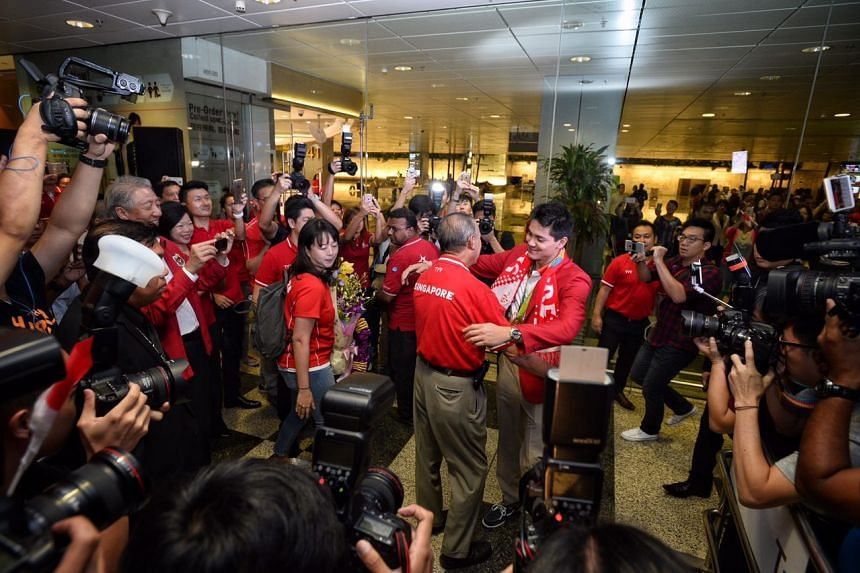 Joseph Schooling hugs his father Colin Schooling upon arrival at Changi Airport.