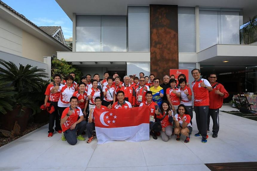 President Tony Tan Keng Yam with the Singapore Olympic team at the Singapore House in Rio de Janeiro.