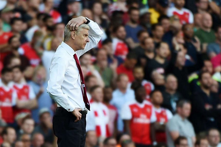 Arsenal manager Arsene Wenger reacts during his team's 4-3 loss to Liverpool in an English Premier League soccer match at the Emirates Stadium in London, Britain, on Aug 14, 2016.