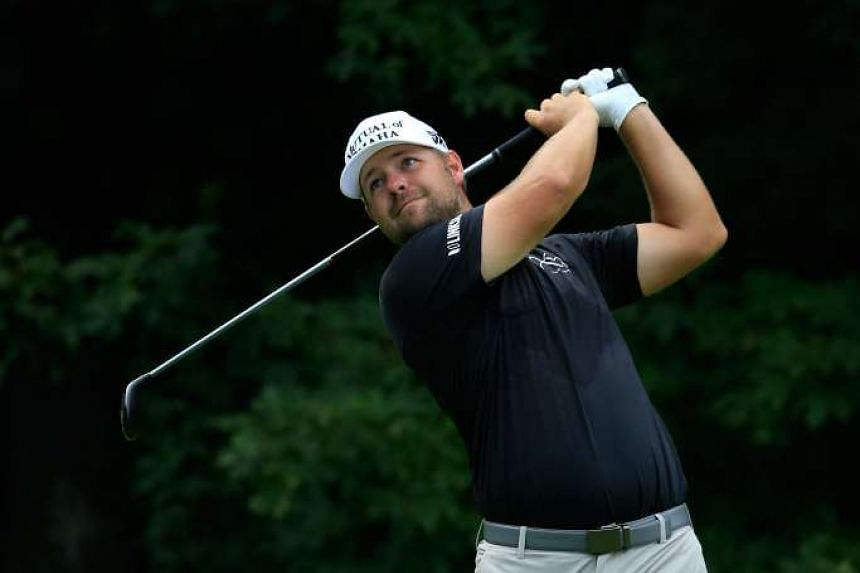 Ryan Moore plays his shot from the 12th tee during the final round of the John Deere Classic at TPC Deere Run on Aug 14, 2016.