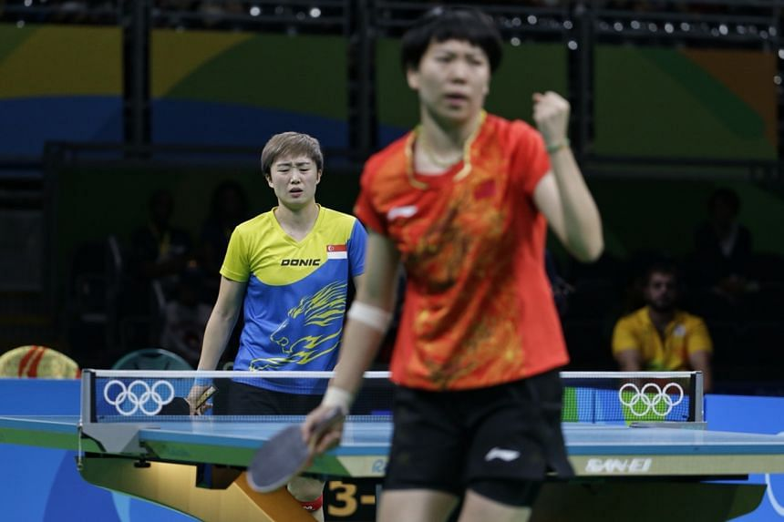Feng Tianwei reacting after China's Li Xiaoxia scores a point, during their match in the table tennis women's team semi-finals in Rio de Janeiro on Aug 15, 2016.