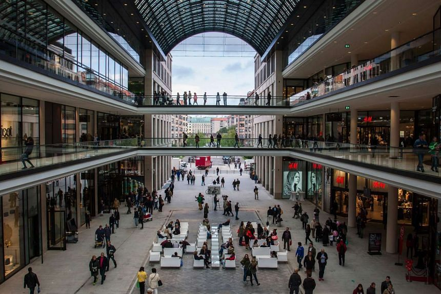 People gathering inside the central square of LP12 Mall of Berlin.